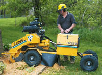 Vermeer SC252 Stump Cutter in action.